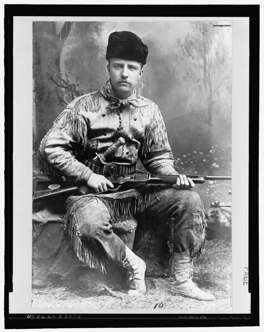 Theodore_Roosevelt_with_hunting_suit_and_rifle_3a24199u_original (1)